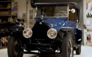 A blue 1916 Owen Magnetic car that has been restored by Jay Leno's Garage; the restoration process used 3D scanning.