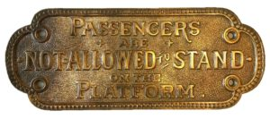 "Original brass plaque from NC DOT dating back to the late 1800's stating ""Passengers are not allowed to stand on the platform."""