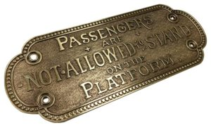 "Brass Plated 3D printed plaque, which reads, ""Passengers are not allowed to stand on the platform.""3D printed plaque wwith metal plating in brass, which reads, ""Passengers are not allowed to stand on the platform."""