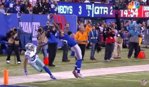 Color photo of Odell Beckham's famous one-handed catch in 2014 for the NY Giants football team.