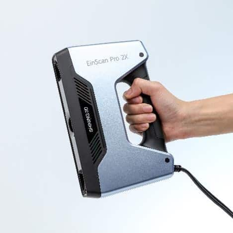 EinScan Pro 2X handheld 3D scanner with user holding it in his right hand.